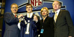 NEW YORK - APRIL 24:  Eli Manning (2nd-L) with his parents receives a San Diego Chargers jersey from NFL Commissioner Paul Tagliabue during the 2004 NFL Draft on April 24, 2004 at Madison Square Garden in New York City. Manning was selected first pick overall by the San Diego Chargers then traded to the New York Giants for Philip Rivers and 3 draft picks.  (Photo by Chris Trotman/Getty Images)